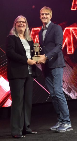 Video game director Amy Hennig is stood next to PlayStation System Architect Mark Cerny, following her lifetime achievement award at the Game Developers Choice Awards in 2019